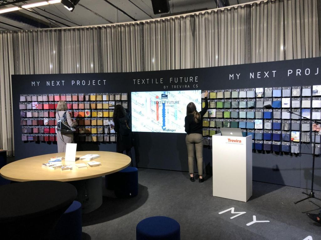 Image of lady selecting Abbotsford Trevira CS Fabrics at Heimtextil 2020 Show